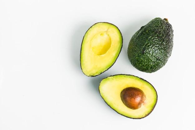 Avocado on a dark wood background Free Photo