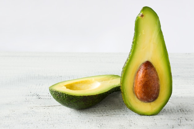 Avocado food background with fresh organic avocado on old wooden table, copy space Free Photo