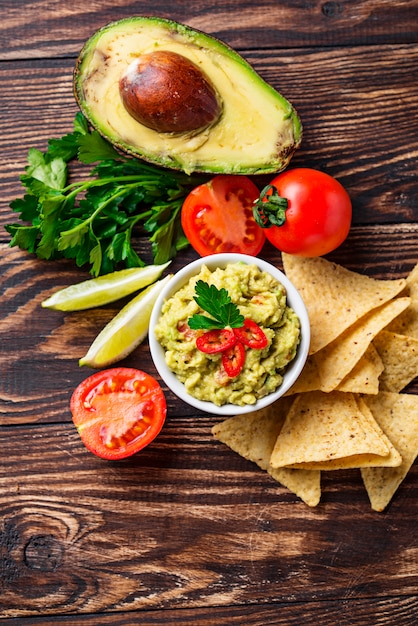Avocado sauce guacamole with corn chips nachos Premium Photo