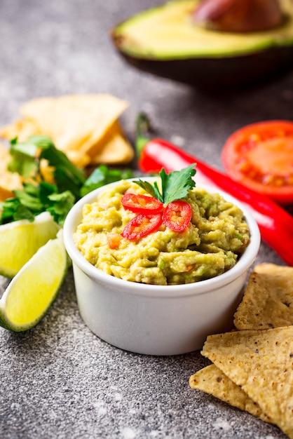 Avocado sauce guacamole with corn chips nachos Premium Photo