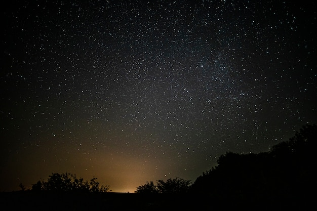 Awesome starry night sky with beam of light Premium Photo