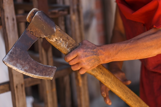 The ax in the hand of the medieval executioner Premium Photo