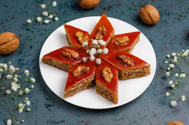 Azerbaijan national pastry pakhlava on white plate  ,top view,spring new year celebration novruz holiday. Free Photo