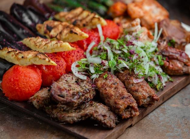 Azerbaijani lyulya kebab with potatoes and vegetables Free Photo