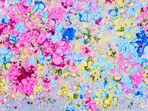 Azure liquid mixing with ornamental stars and bright crumbs Free Photo