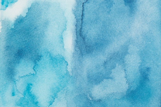 Azure mix of paints on paper Free Photo