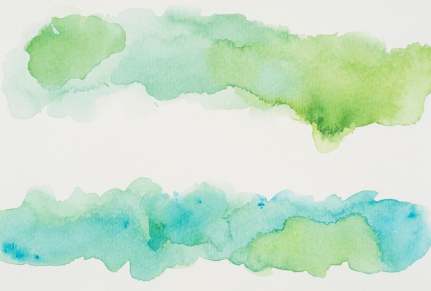 Azure and verdant paints on white paper Free Photo