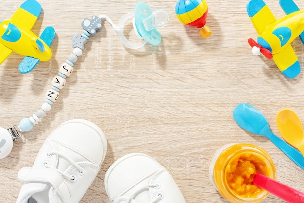 Baby accessories for healthcare, playing and feeding on table. flat lay. baby or children concept. Free Photo