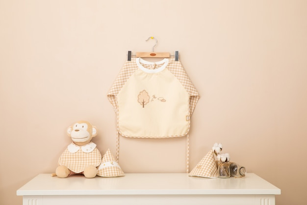 Baby apron and baby colthes are washing and drying on the rack bars. Premium Photo