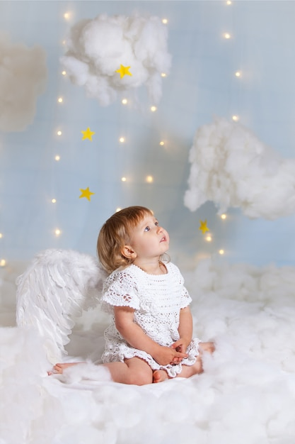 The baby as the angel soaring in clouds Premium Photo