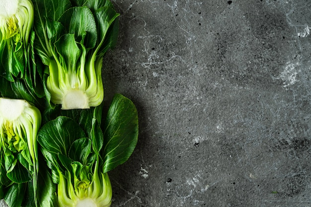 Baby bok choi halves on gray background. top view with copy space. horizontal image Premium Photo