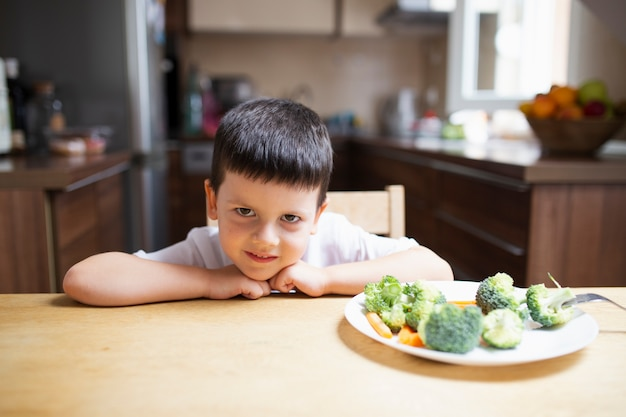 Baby boy refusing healthy food Free Photo