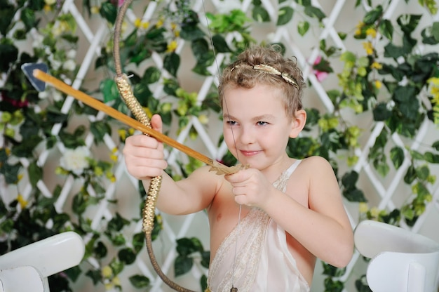 Baby cupid shoots a bow Premium Photo