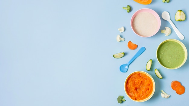 Baby food frame on blue background Free Photo