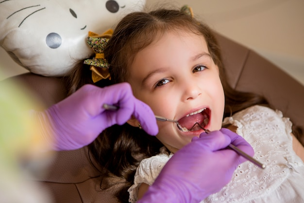 Baby girl at the dentist Premium Photo