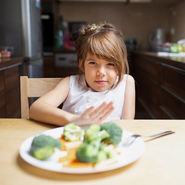 Baby girl having enough healthy food Free Photo