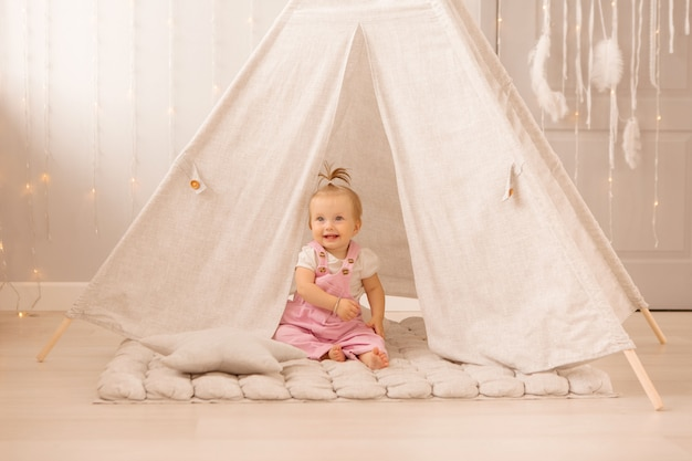 Baby girl playing in the nursery Premium Photo