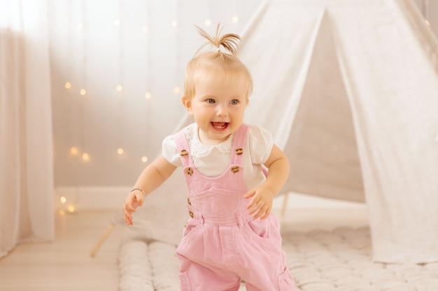 Baby girl playing in the nursery Premium Photo