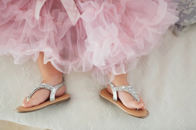 silver shoes and fancy pink dress
