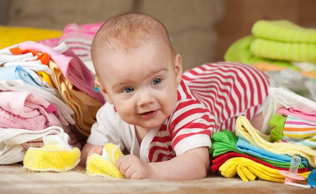 Baby girl with  children's wear Free Photo