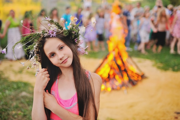 Baby girl in a wreath of wildflowers Premium Photo