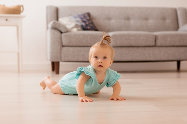 Baby is lying on the floor in the room Premium Photo