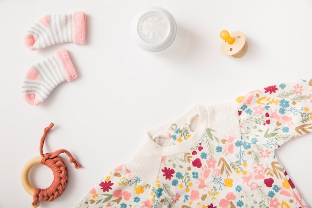 a0c366efe262 Baby s clothing and socks with pacifier and toy isolated on white ...