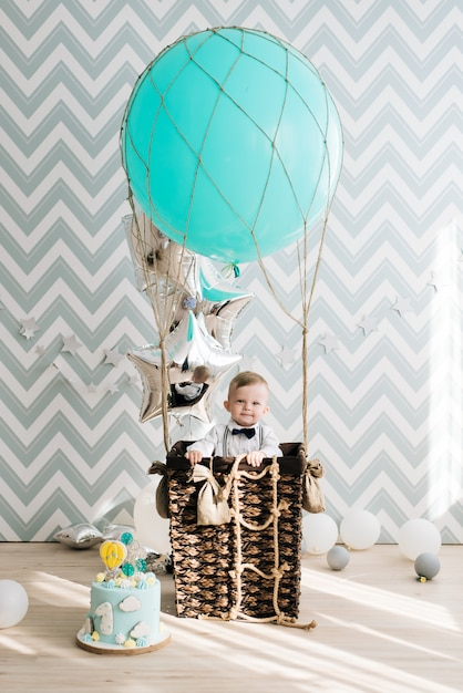 Baby's first birthday. cute smiling baby is 1 year old. the concept of a children's party with balloons Premium Photo