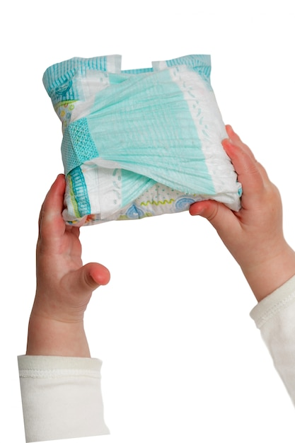 Baby's hands hold dirty diapers isolated on the white Premium Photo