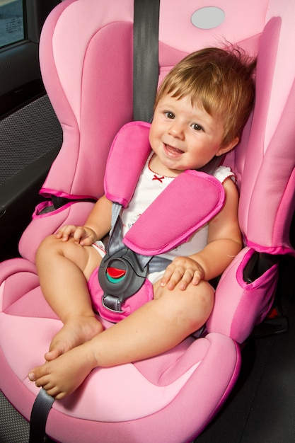Baby in a safety car seat. safety and security Premium Photo