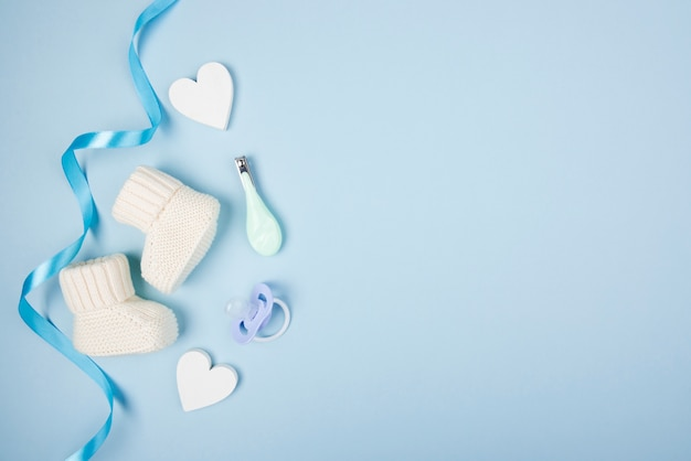 Baby socks and pacifier Free Photo