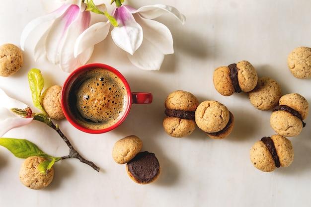 Baci di dama hazelnut biscuits Premium Photo