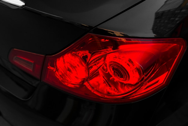 Back of black car with red rear light Free Photo