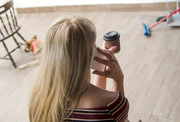 c26a58cc30dd Back of blonde girl talk on cell phone Photo   Premium Download