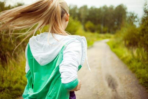 Back girls runner on the road, morning jog Premium Photo