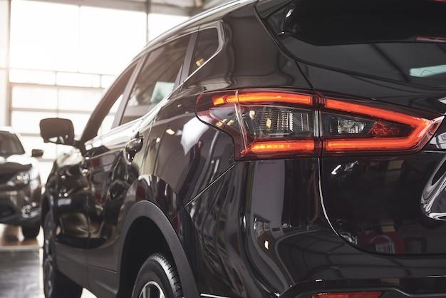 The back headlights of a black luxury car. Free Photo