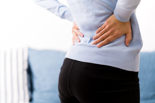 Back pain at home. women suffer from backache. healthcare and medical concept Premium Photo