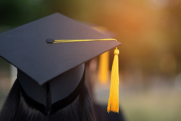Premium Photo | Back portrait of graduated wearing a black hat.