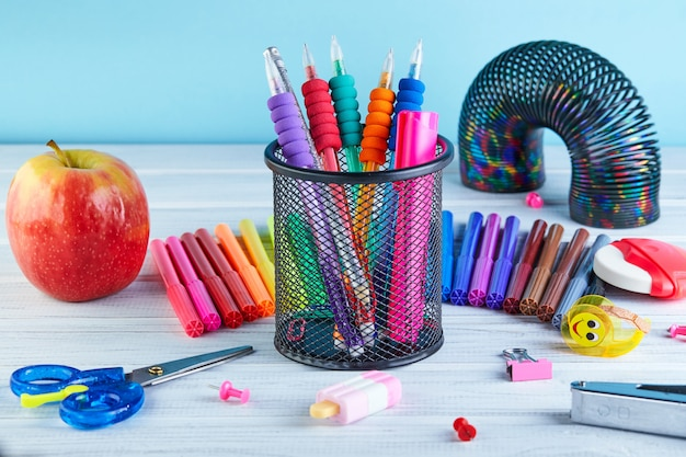 Back to school background with accessories for the schoolroom Premium Photo