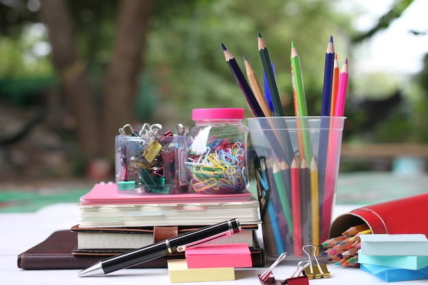 Back to school concept.books and supplies on white wooden floor. Premium Photo