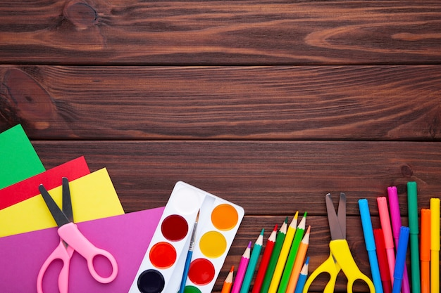 Back to school concept on brown wooden background Premium Photo