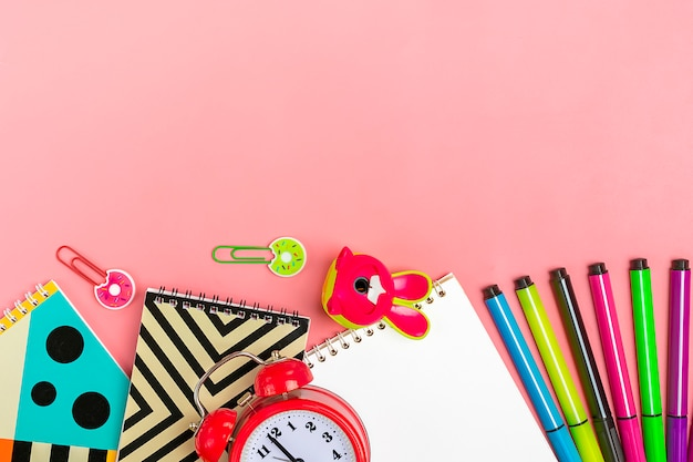 Back to school concept. school supplies on pink, flat lay. Premium Photo