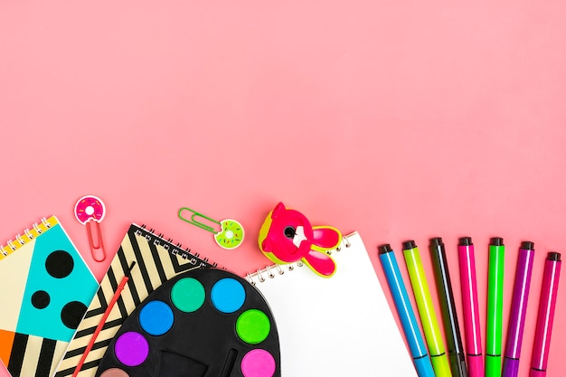 Back to school concept. school supplies on pink, flat lay Premium Photo
