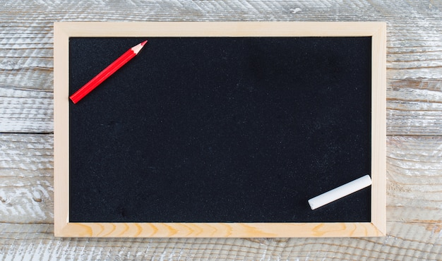 Back to school concept with pencil, chalk on wooden background flat lay. Free Photo