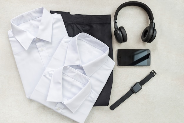 Back to school concept with uniform and electronic devices Premium Photo