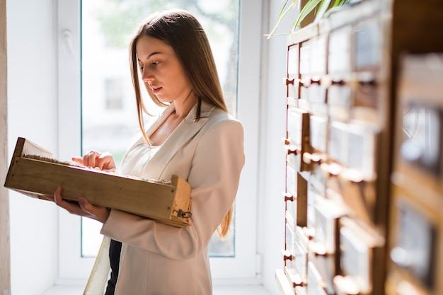 Back to school concept with woman studying in library Free Photo