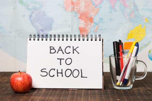 Back to school greeting with world map background Free Photo