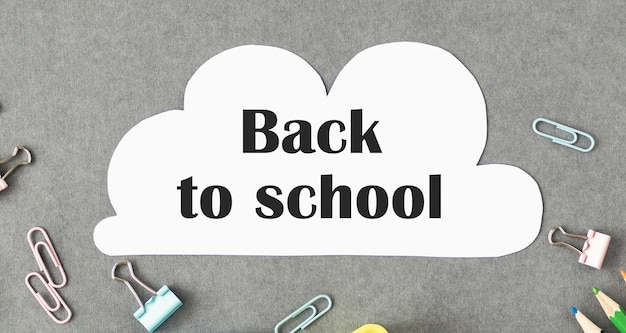 Back to school text with school supplies Premium Photo