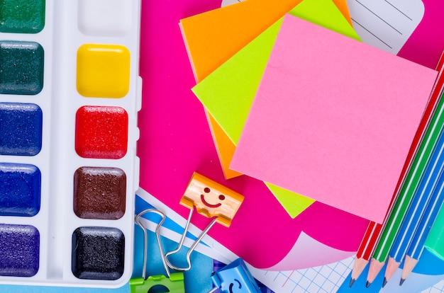 Back to school with schools accessories - paints, pencils, notebooks, scissors, markers Premium Photo