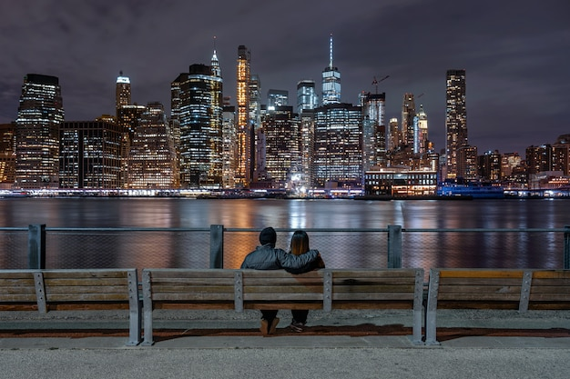 Back Side Couple Sitting And Looking New York Cityscape